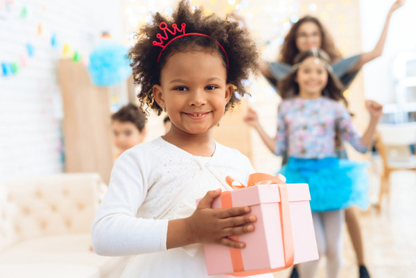 Little Girl Holding Birthday Gift