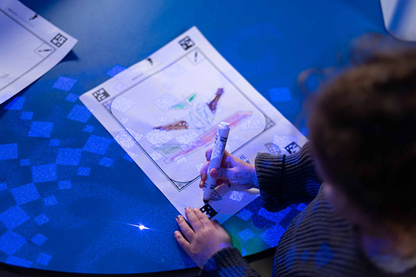 child coloring a picture in the animation art room at Ready Set FUN!