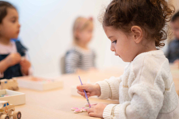 little girl painting in arts and crafts class at Ready Set FUN!