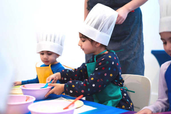 boy and girl participating in kids cooking class at Ready Set FUN!
